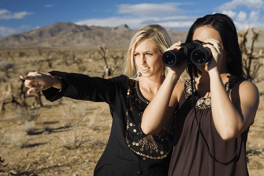 Women searching using binoculars