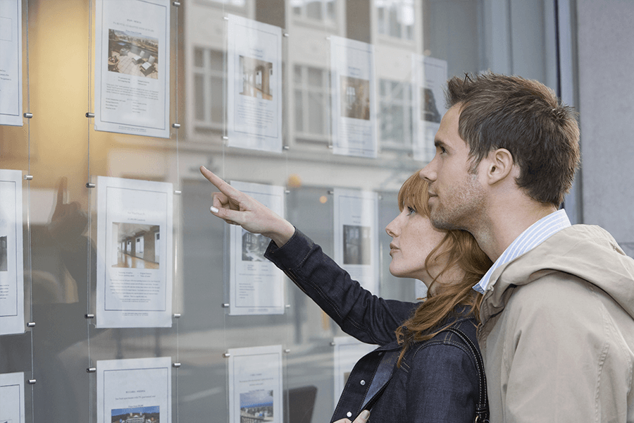 Couple looking at property flyers