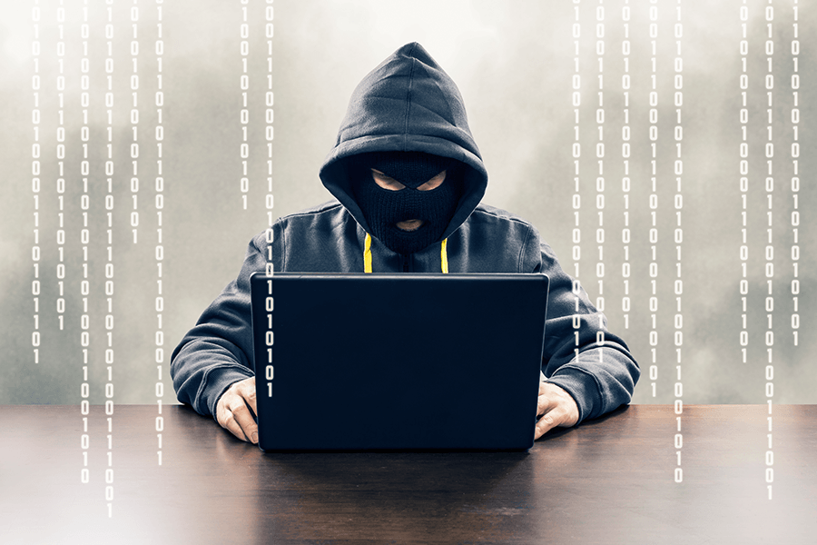 Image of cyber hacker with laptop