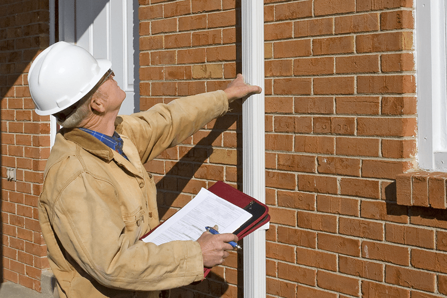 Appraiser inspecting a property