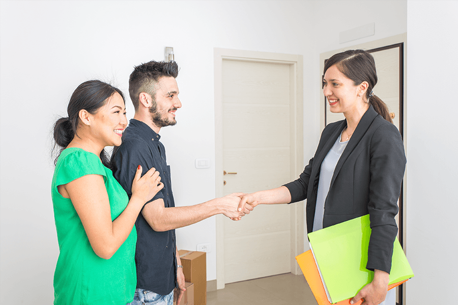 couple shakes hands with their REALTOR®