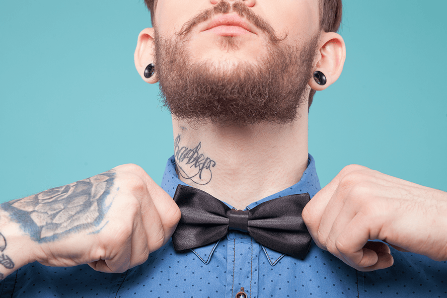Young professional with bowtie and tattoos